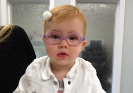 Little Miss is so excited to be picking up her very first pair of glasses! How sweet does she look in those baby pink frames?