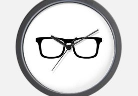 Wall clock with eyeglasses background