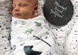 Swaddled baby Maverick