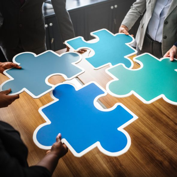 Staff training abstract image with large puzzle pieces