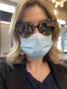 Sarah trying on sunglasses in Royal Oak Optometry